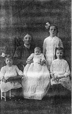 christening photo of Robert with his sisters and mother